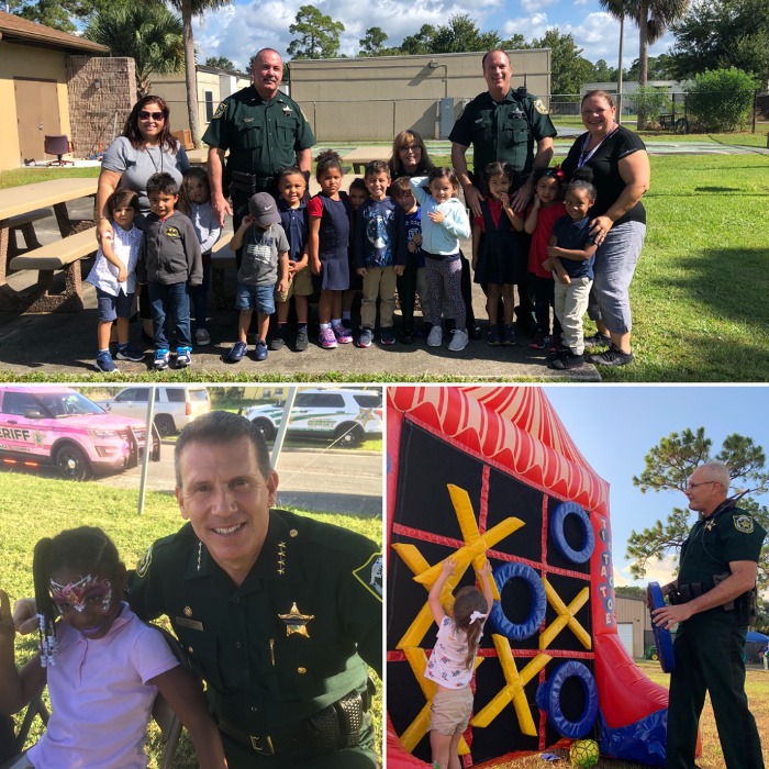 Sheriff and deputies with community members at the 2019 National Night Out event