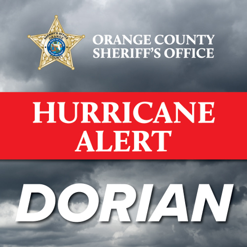 Ominous clouds with text reading Hurricane Dorian Alert
