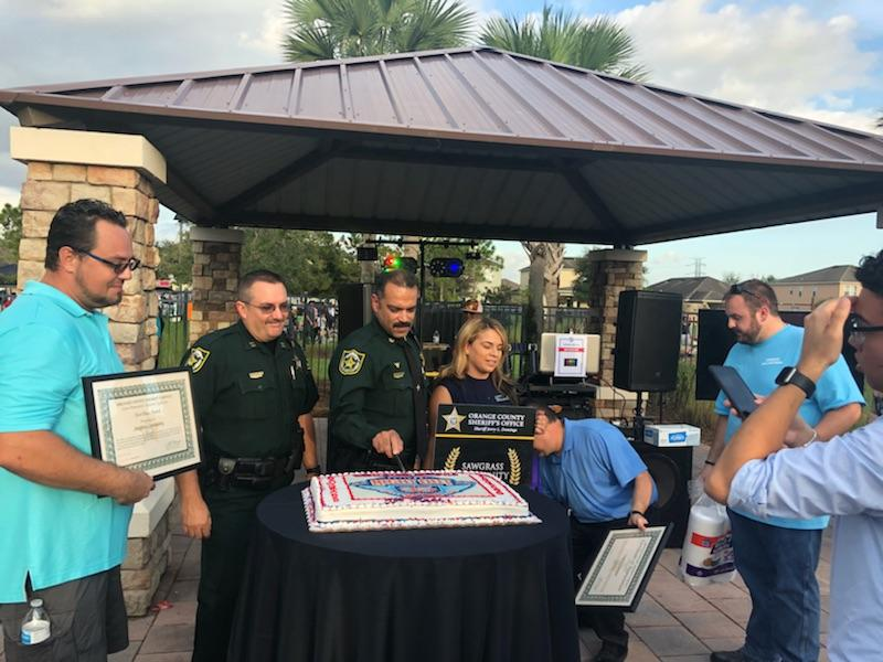 Deputies and community members with National Night Out cake
