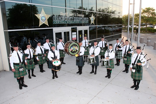 Pipes and drums standing outside Sheriff's Office Central Complex