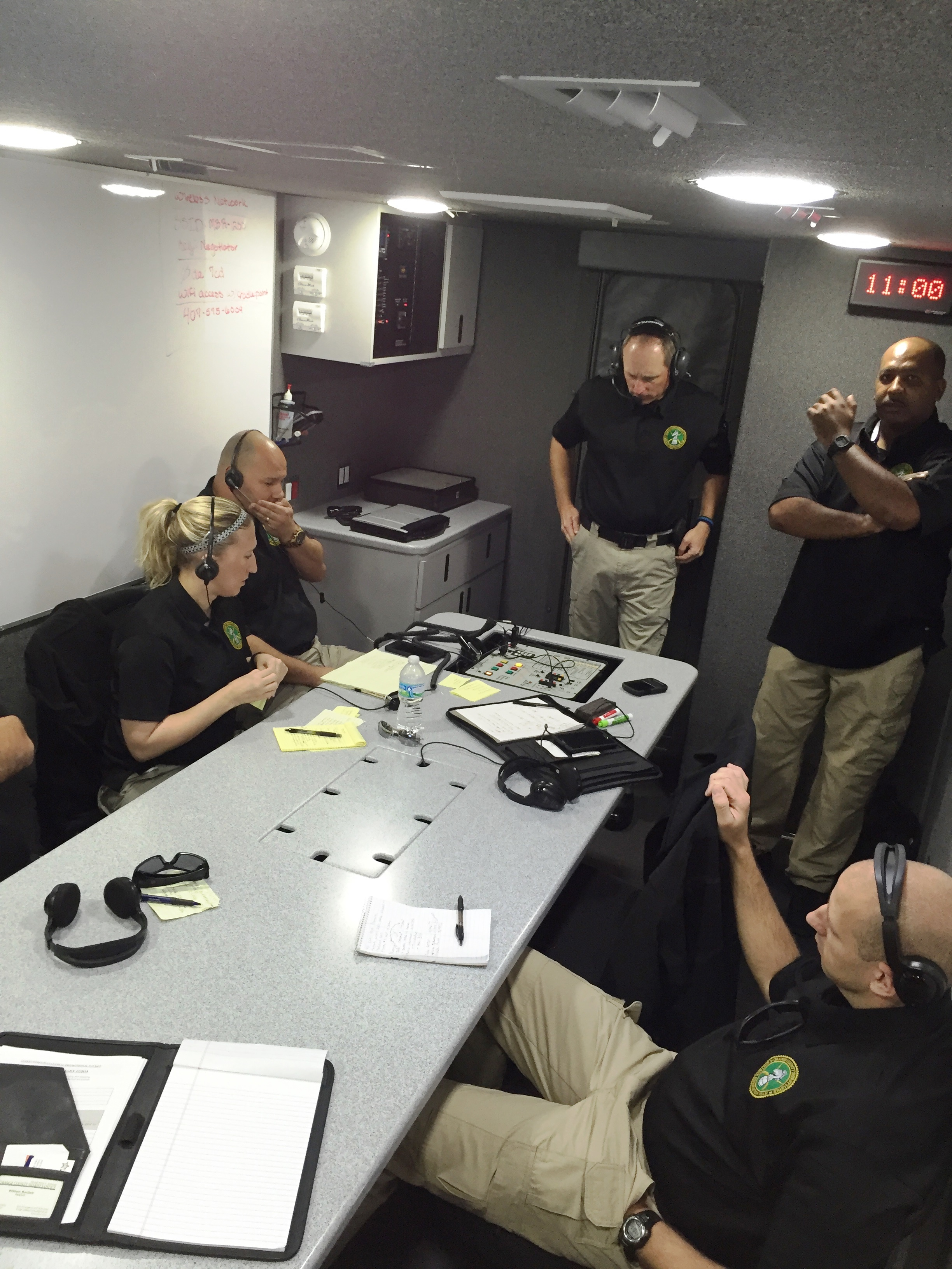 Hostage negotiation team in command center responding to crisis