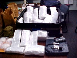 Packages of white powder seized by Narcotics Unit