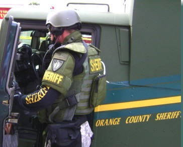 Deputy in protective gear outside SWAT truck