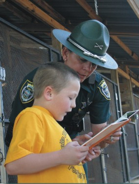 OSCO Deputy working with a child