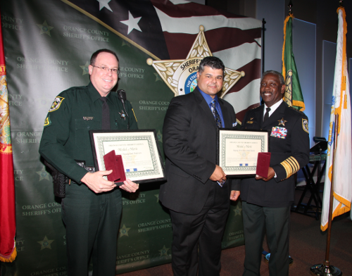 February 2018 Medal of Merit Recipients Captain John Caraballo and DFC Ismael Nieves with Sheriff Demings