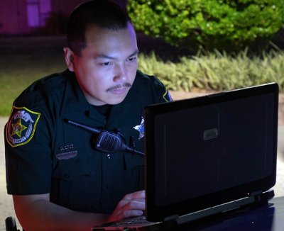 Deputy in front of Laptop Computer outside