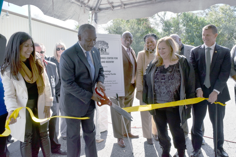 Sheriff and Mayor Elect Jerry Demings cuts the ribbon on the new Recovery and Reentry Center.