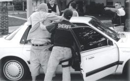OCSO deputy removing suspect from a vehicle