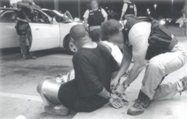 Deputy placing handcuffs on suspect