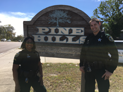 OCSO deputies after repairing the Pine Hills sign